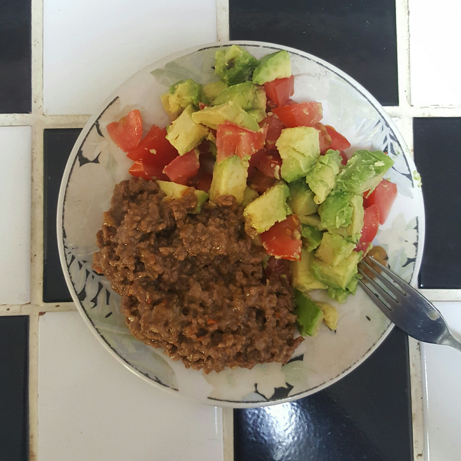 Onion, celery and pepper infused sauce on mince with tomato and avo salsa