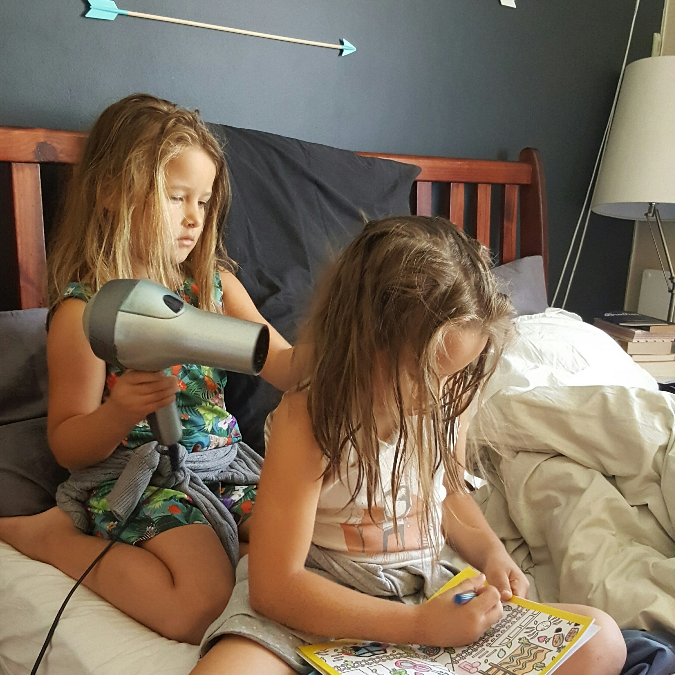 sisters drying each others hair